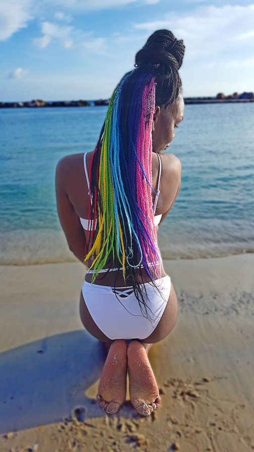 Sitting pretty with my rainbow hair at Mambo Beach Curacao