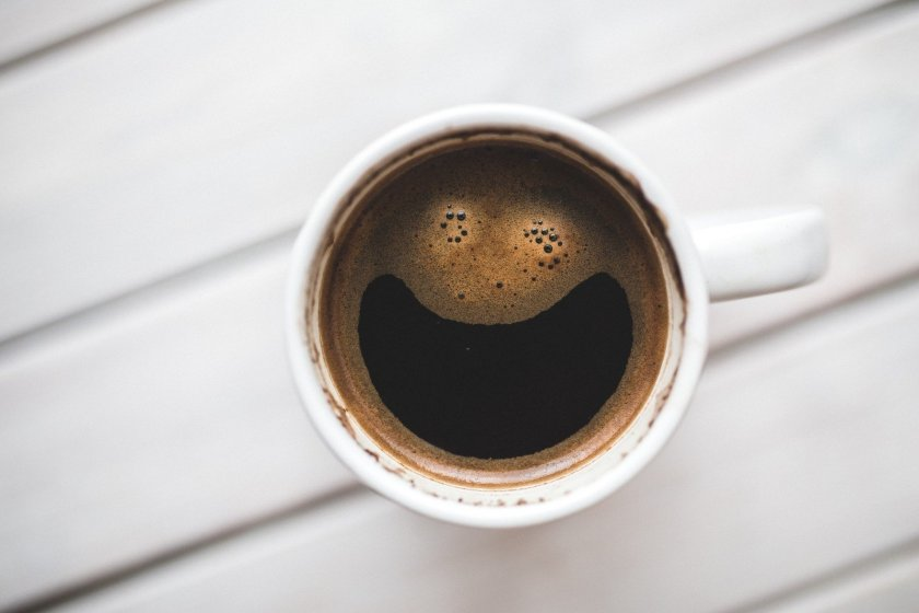 A cup of coffee with a smile