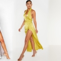 3 women posing in glamorous dresses