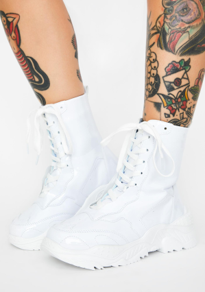 Tattooed legs white chunky sneakers